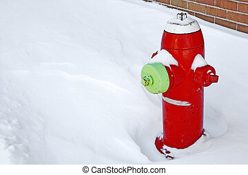 Red fire hydrant in the snow