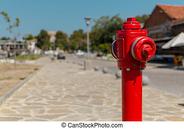 red fire hydrant on blurred background - red fire hydrant in...