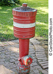 Red Fire Hydrant on  City Sidewalk