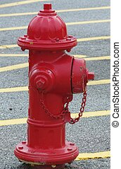 RED FIRE HYDRANT - A red fire hydrant with yellow lines in...
