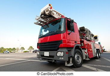 Red fire truck - Red fire engine, is waiting for departure.