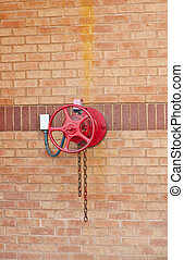 Red Fire Valve on Brick Wall