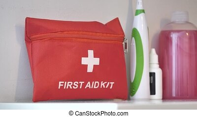 First aid kit placed on shelf in case of injury at home or at work