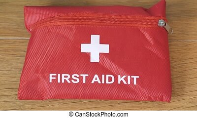 First aid kit placed on shelf in case of injury at home or at work top view