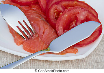 Red fish and ripe tomatoes