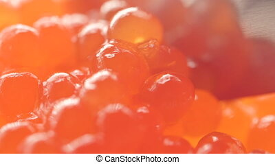 Red fish embryos in the delicacy fresh red caviar. Macro...