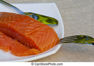 Red fish on a white plate