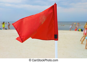 Red flag on the beach of the Baltic Sea