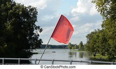 red flag on the bridge and wind