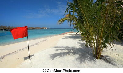 Red Flag on this Tropical Beach Paradise in the Maldives
