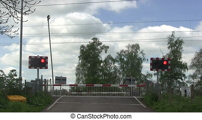 Red flashing lights at a level cros