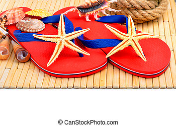 Red flip-flops, slippers with flowers on the wooden background