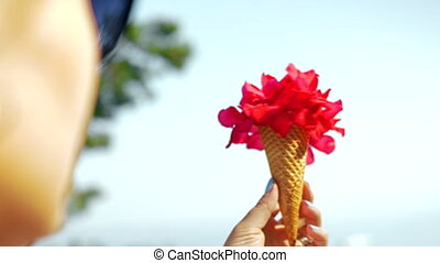 Red flower and waffle cone composition - Close-up shot of a...