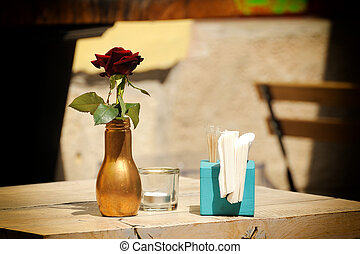 Red flower in a glass bottle.