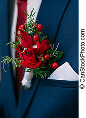 Red Flower in the buttonhole of his jacket groom. Wedding ...
