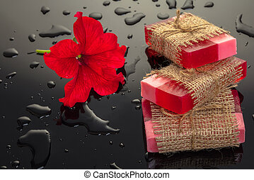 red flower soap handmade on a black background