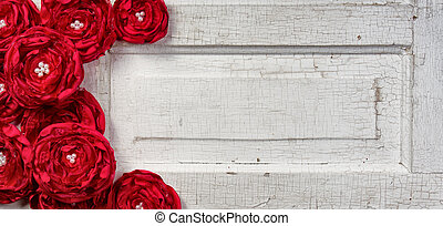 red flowers on vintage door - Red shabby chic flowers on...