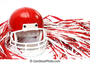 Red football helmet and pom poms isolated on white...