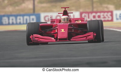 Red formula one race car driving across finish line