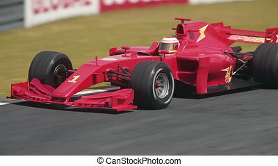 Red formula one race car driving through hairpin curve