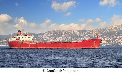 Red Freighter - Cargo ship in still waters in the morning...