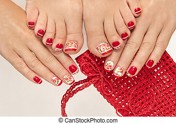 Red French manicure and pedicure .