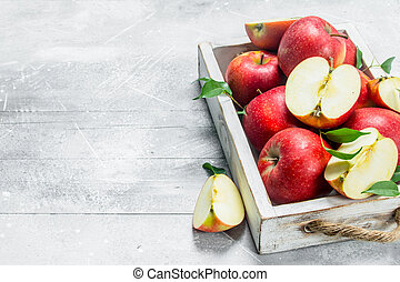 Red fresh apples in a wooden box.