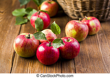 red fresh apples on a table