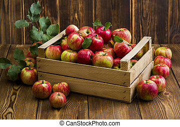 red fresh apples on a wooden table