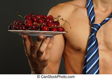Red fresh cherry on plate