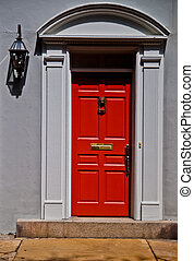 Red Front Door - wooden red front door on a stone gray...