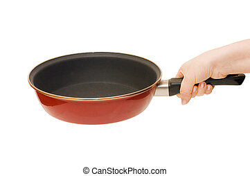 Red frying pan in a hand isolated