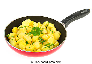 Red frying pan new potatoes