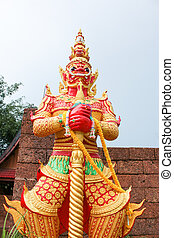 red giant statue standing front of wall in temple