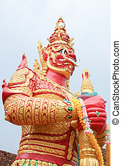 red giant statue standing on white sky background