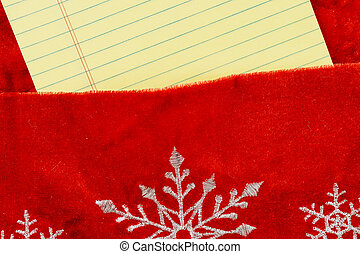 Red gift bag Christmas on yellow notebook for notes