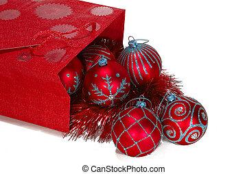 Red gift bag full of christmas toys