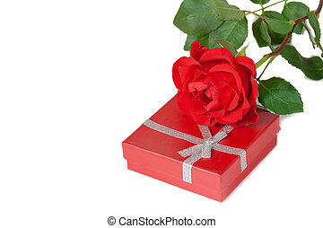 Red gift box and red rose on a white background