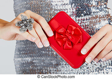 red gift box in woman's hands. - red gift box with satin bow...