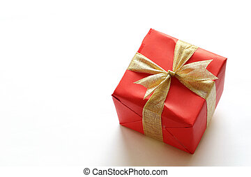 Red gift box isolated on white with close-up.