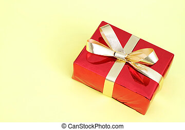 Red gift box on a yellow background