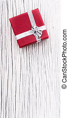 Red Gift Box on White Wooden Background