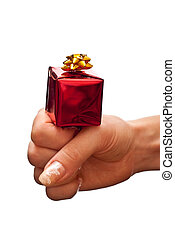 Red gift box on woman's hand