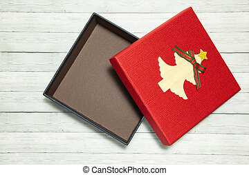 Red gift box on wooden background, top view