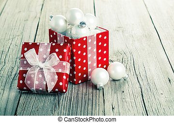 red gift box, polka dots with christmas decoration, on wood...
