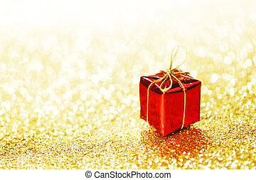 Red gift box - Red decorative box with holiday gift on gold...