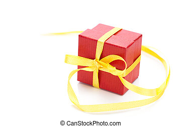 red gift box with a yellow ribbon isolated on white