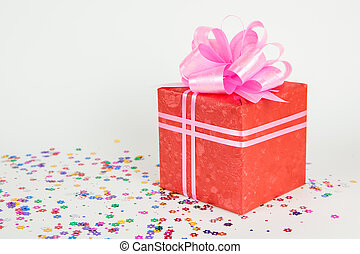 red gift box with pink ribbon and bow