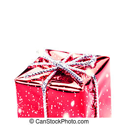 Red gift box with silver ribbon, bow and snowflakes isolated on white macro. Christmas, Valentine's, Birthday gift box