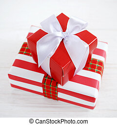 Red gift box with white ribbons